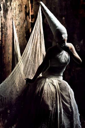Shot of a twilight girl in white dress. Halloween, horror. Stock Photo - 7552244