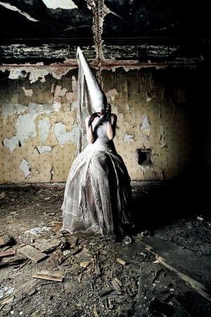 gloomy: Shot of a twilight girl in white dress. Halloween, horror. Stock Photo
