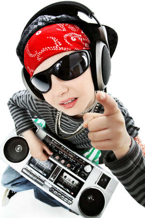 Shot of a trendy teenager listening to music in headphones. Isolated over white background. photo