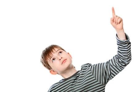 Educational theme: boy teenager showing upward. Isolated over white background. photo