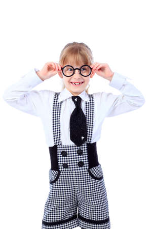 Shot of a little girl in glasses. Isolated over white background. photo