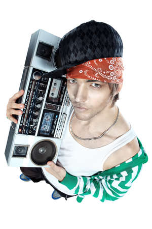 Trendy young man posing with tape recorder.  photo