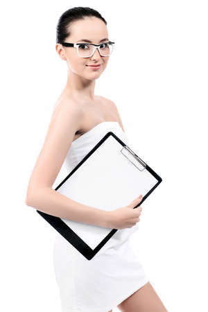 Beautiful young woman posing with worksheet. Isolated over white background. photo