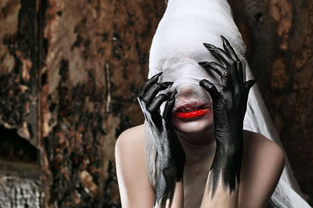 twilight: Shot of a twilight girl in white dress. Halloween, horror. Stock Photo