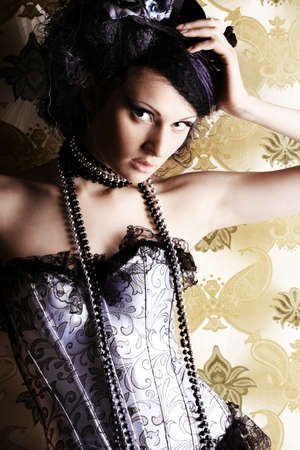 Beautiful fashionable woman over vintage background. Stock Photo - 7552403