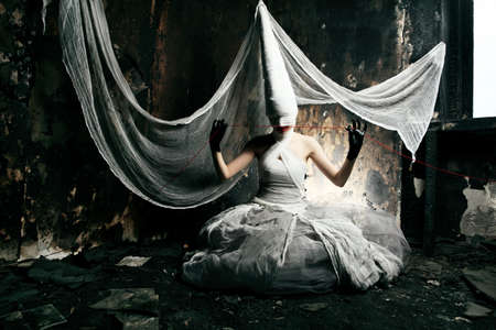 horror movies: Shot of a twilight girl in white dress. Halloween, horror. Stock Photo