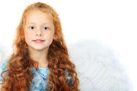 Portrait of a cute red-haired girl angel. Isolated over white background. photo