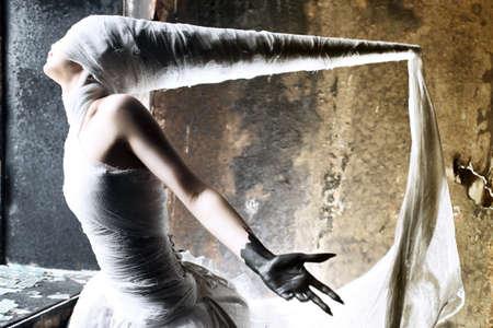 Shot of a twilight girl in white dress. Halloween, horror. Stock Photo - 7552373