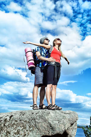 Couple of tourists making their journey at the mountains. Stock Photo - 7552407