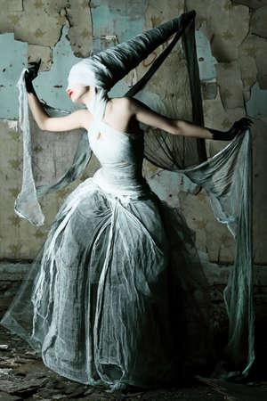 Shot of a twilight girl in white dress. Halloween, horror. Stock Photo - 7552436