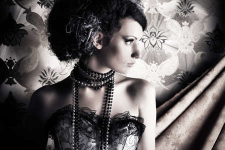 antique woman: Beautiful fashionable woman over vintage background.
