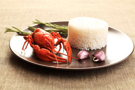 A dish with steamed white rice and boiled crawfish. photo