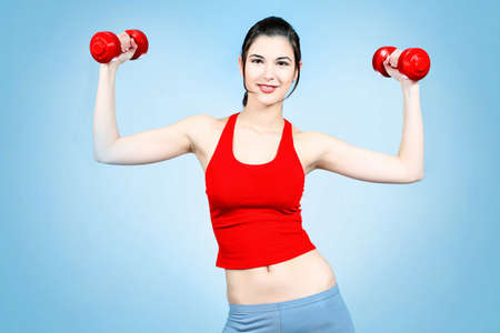 lifting hands: Shot of a young woman with dumbbells. Active sporty life, wellness. Stock Photo