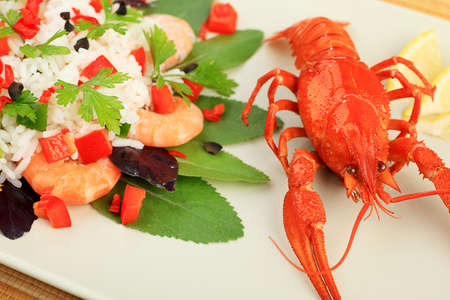A dish with steamed white rice,  shrimps and boiled crawfish. photo