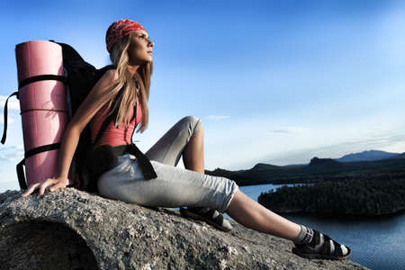 Young woman tourist posing at the mountains. Stock Photo - 7632696