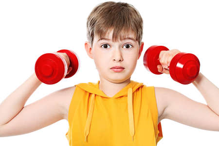 Shot of a sporty boy teenager with dumbbells. Isolated over white background. photo