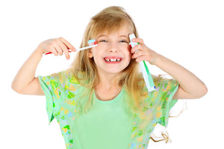 Portrait of a little girl cleaning her teeth with a tooth brush. Isolated over white background. Stock Photo - 7632710