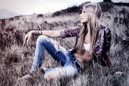 hippie woman: Beautiful young woman hippie posing over picturesque landscape. Stock Photo