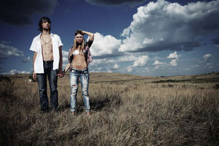 gypsy woman: Beautiful young couple hippie posing together over picturesque landscape.