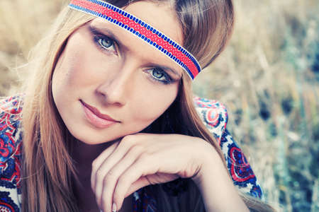 Beautiful young woman hippie posing outdoor. Stock Photo