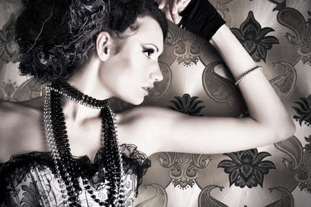 Beautiful fashionable woman over vintage background. photo