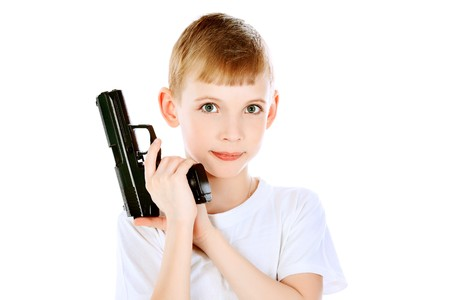 Shot of a boy with a gun. Isolated over white background. Stock Photo - 7647634