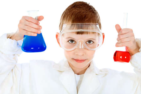 Shot of a little boy in a doctors uniform. Isolated over white background. photo