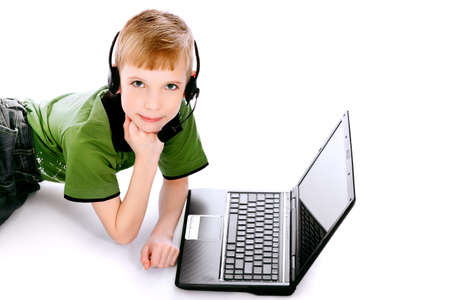 Shot of a boy lying on a floor with his laptop. Isolated over white background. photo