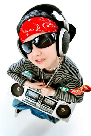 cool boy: Shot of a trendy teenager listening to music in headphones. Isolated over white background.