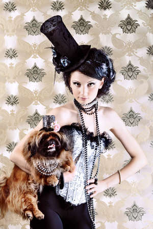 Portrait of a fashionable lady with a dog over vintage background. Stock Photo - 7703209