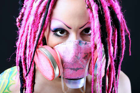 Cosplay young woman in respirator over black background. photo