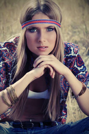 Beautiful young woman hippie posing outdoor. photo