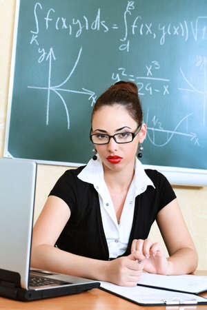 Educational theme: college teacher giving a lecture to students. photo