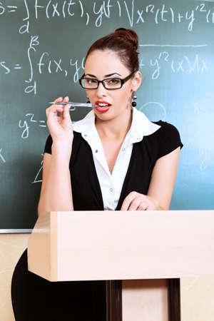 Educational theme: portrait of an attractive teacher. photo