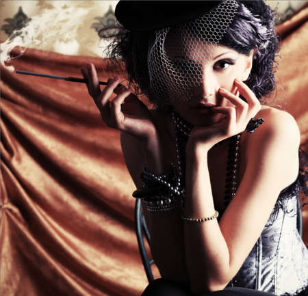 Portrait of a fashionable lady over vintage background. Stock Photo - 7803082