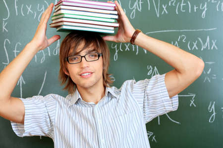 Educational theme: male student in a classroom. photo