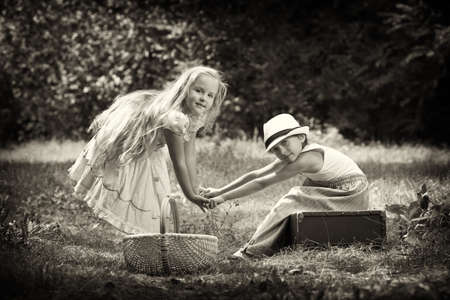 little boy and girl: Two beautiful children walking together. Retro style.