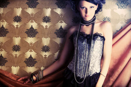 Beautiful fashionable woman over vintage background. Stock Photo - 7803259