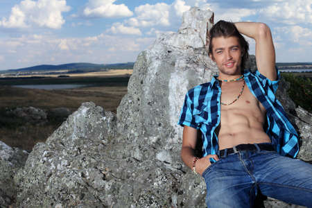 gypsies: Handsome young man hippie posing over picturesque landscape.