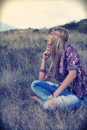 Beautiful young woman hippie posing over picturesque landscape. Stock Photo - 7803258