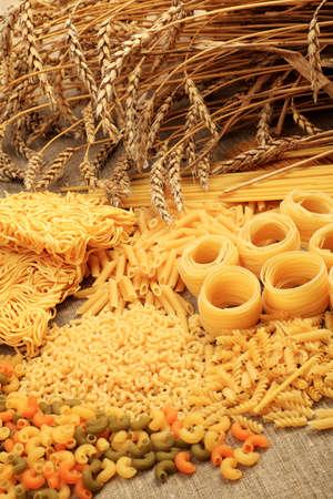 Food theme: uncooked pasta background. 版權商用圖片
