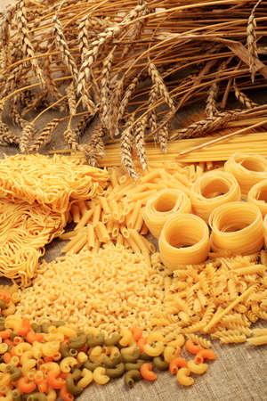 Food theme: uncooked pasta background. photo