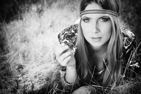 Beautiful young woman hippie posing outdoor. photo