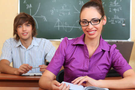 Educational theme: happy students in a classroom. photo