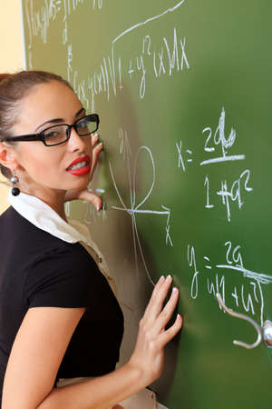 Educational theme: portrait of an attractive teacher. photo