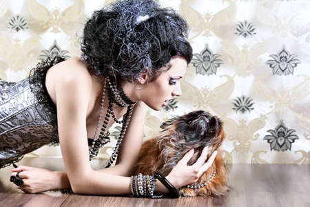 Portrait of a fashionable lady with a dog over vintage background. Stock Photo - 7907198