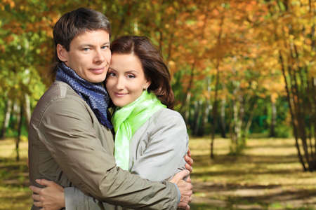 Happy married couple at the autumn park. photo