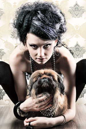Portrait of a fashionable lady with a dog over vintage background. Stock Photo - 7907202