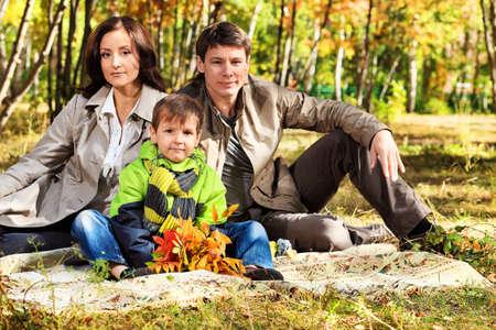 Happy family walking at the autumn park. photo