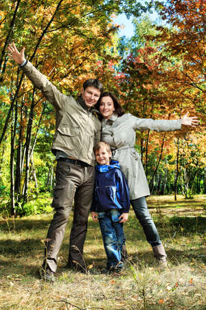 Happy family walking at the autumn park. photo